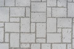 A pattern of a Romano pavement taken from above in a park, executed with gray cobblestones royalty free stock photography