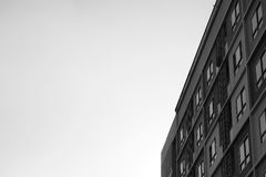 Pattern of rooms block apartment condominium style with a bird standing on the rooftop. Monotone black and white theme of pattern rooms block apartment Royalty Free Stock Photography