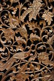 Pattern of rose carved on wood. Wood carve in thailand  house decorate Stock Photography