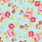 Pattern with roses on a background of snowflakes Stock Photo