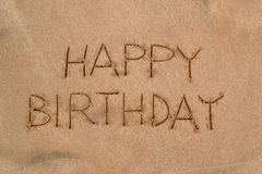 Pattern in the sand - happy birthday. Inscription (picture) in the sand by the sea Royalty Free Stock Image