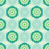 The pattern is seamless, abstract, from mandalas in green tones. For wallpaper, paper, oilcloth, tiles. Stock Images