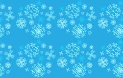The pattern is seamless from beautiful, Christmas, carved, new-year, festive unique blue, turquoise and white snowflakes of differ Stock Photography