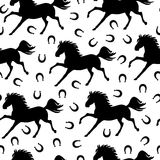 Pattern seamless of galloping horses and horseshoes Royalty Free Stock Photo