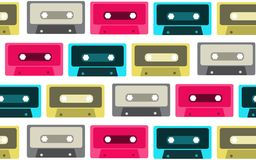 The pattern is seamless from old, vintage, retro, hipster, antique, colorful, bright, motley, blue, pink, gray audio cassettes fro. M the 80`s, 90`s on a white Royalty Free Stock Image