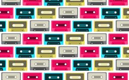 The pattern is seamless from old, vintage, retro, hipster, antique, colorful, bright, motley, blue, pink, gray, yellow audio casse. Ttes from the 80`s, 90`s on a Stock Photos