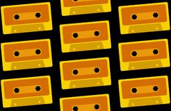 The pattern is seamless from old, vintage, retro, hipster, antique, yellow, gold audio cassettes from the 80`s, 90`s on a black. Background. Vector illustration Royalty Free Stock Photos