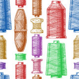 Pattern with sewing thread bobbins Stock Photography