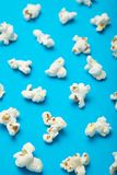 Pattern with a shadow of popcorn on a blue background stock illustration