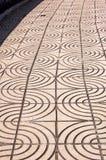 Pattern in sidewalk. Details of a wavy pattern in a concrete sidewalk stock photography