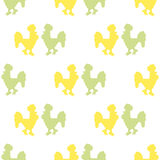 The pattern of silhouettes of roosters. Seamless ornamental pattern composed of silhouettes of colorful roosters on a light background Royalty Free Stock Images