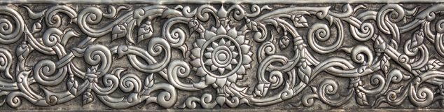 Pattern of silver metal plate with flower carved background. Thai style in temple Royalty Free Stock Photos