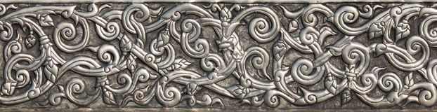 Pattern of silver metal plate with flower carved background Royalty Free Stock Photos