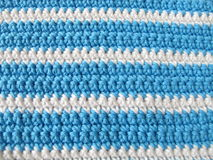 Pattern from single crochet stitch in white and blue Royalty Free Stock Image