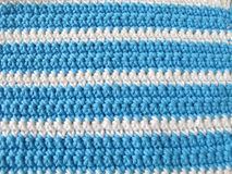 Pattern from single crochet stitch in white and blue Royalty Free Stock Images