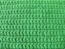 Pattern from single crotchet stitch in green Royalty Free Stock Photo