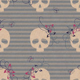 Pattern with skulls and flowers. On vintage brown paper Stock Photos