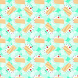 Pattern with slices of birthday cake on green background. royalty free stock images