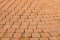 Pattern of small brown brick block from walkway Stock Image