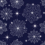 Pattern with snowflakes. Winter blue seamless background with snowflakes and stars Royalty Free Stock Photography