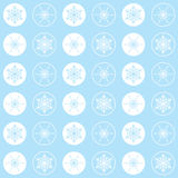 Pattern snowflakes light cyan. Christmas seamless refined pattern with circles and elegant snowflakes on a light blue background, pastel colors Royalty Free Stock Image