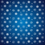 Pattern of snowflakes and stars on a blue Royalty Free Stock Photo