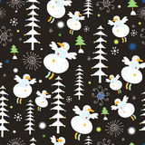 Pattern of snowmen and Christmas trees. Seamless white pattern of snowmen and Christmas trees on a dark background Royalty Free Stock Photo