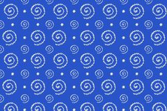 Pattern with spirals made from sugar decor in form of snowflakes. On blue background. Minimal Christmas and New Year`s concept stock photography