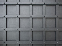 Pattern of squares grid on a gray iron door Royalty Free Stock Images