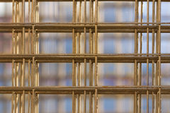 Pattern from stack of rebar grids on blue background Royalty Free Stock Image