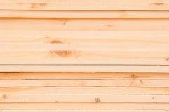 Pattern of stacked rectangular wooden beam timber at sawmill lumberyard Royalty Free Stock Photo