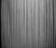 Pattern of steel rods against a rough wall - Royalty Free Stock Photos