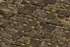 Pattern stone grey uneven wall urban design base rigid weathered surface royalty free stock image