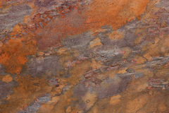 Pattern of a stone plate in orange, ocher, silver, purple Royalty Free Stock Images