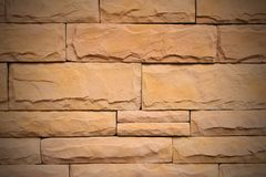 Pattern stone wall texture for design and interior,close up old brown bricks wall Stock Photos