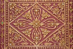 Pattern stucco gold red temple wall background Royalty Free Stock Image