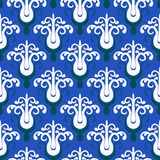Pattern with stylized trees on blue Royalty Free Stock Photo