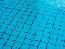 Pattern of sunlight on the bottom of a pool. stock photography