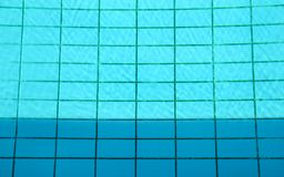 Pattern of sunlight on the bottom of a pool. Swimming pool. Royalty Free Stock Photos