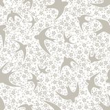 Pattern with swallow and flower. Pattern with flower and silhouettes of swallows. Used as a backdrop, seamless texture. beige background Stock Image