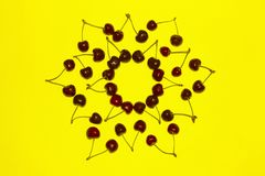Pattern Of Sweet Cherry On Yellow Background. Nature - Fruits Concept. Abstract Colorful Background. Pattern Of Sweet Cherry On Yellow Background. Pattern stock photography