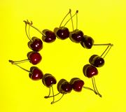 Pattern Of Sweet Cherry On Yellow Background. Food, Summer, Colorful Background.Abstract Colorful Background. Cherry On Yellow Background stock photography