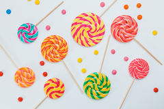 Pattern sweet lollipops, candy on white background, top view fla. T lay. Minimal concept holiday decoration, birthday party, food background Stock Image