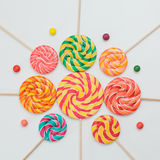 Pattern sweet lollipops, candy on white background, top view fla. T lay. Square shot. Birthday concept. Colorful print Stock Image