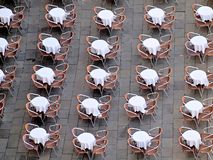 Interesting aerial view of tables and chairs in Venice. Pattern of tables on st. Mark place, aerial view royalty free stock photography