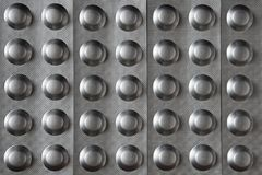 Pattern of tablets in metallized blisters royalty free stock images