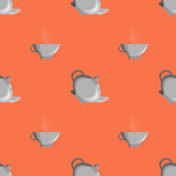 Pattern teapot cup. It can be used as a background or texture. Cup and teapot on the orange background Stock Photos