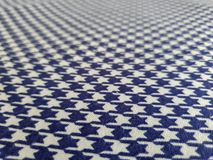 Pattern, texture, background, wallpaper. Soft blue and white cotton sample with geometrical ornament. Close up view stock photo