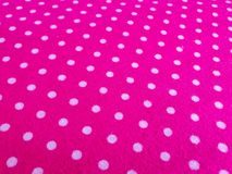 Pattern, texture, background, wallpaper. Soft bright pink cotton sample with white dots, with geometrical ornament. Close up view royalty free stock images
