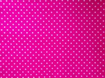 Pattern, texture, background, wallpaper. Soft bright pink cotton sample with white dots, with geometrical ornament. Close up view stock images